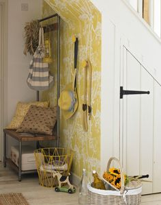 A bright, zesty wallpaper instantly adds pizzazz to this area under the stairs. Choose a bright sunshine yellow patterned wallpaper to recreate the look