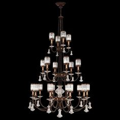Fine Art Lamps Eaton Place 584840ST Chandelier in rustic iron finish with garnet undertones. Features shades of faceted channel-set crystal and brilliant pendants.