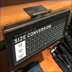 This Shelf-Edge Hinged Metal Size Chart is articulated so that it can easily swing up and out of the way as customers access apparel offerings below. Retail Fixtures, Store Fixtures, Shelf Talkers, Heavy Duty Hinges, Silhouette Sign, Office Phone, Landline Phone, Size Chart, Label