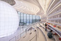 China recently opened a new futuristic library that contains a staggering 1.2 million books. If you enjoy architectural photography, Dutch photographer Oss
