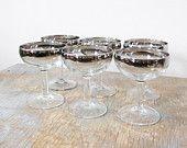 silver champagne glasses / dorothy thorpe champagne glasses / mid century 1960s barware. $96.00, via Etsy.