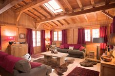 Cool Little Swiss Chalet In Honey Blond Wood : Cool Little Swiss Chalet In Honey Blond Wood With Wooden Living Room Wall And Red Curtain And...