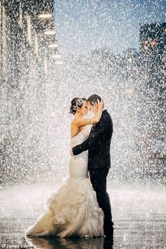 Like a fairytale: Each image shared showed couples and brides all smiles under the rain - all of them loving the unexpected down pour