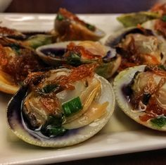 A triumph of flavours, the wild-caught Little Neck Clams, white wine, fish sauce and fried shallots olive oil