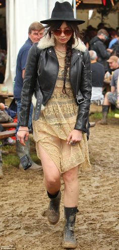 Bring it on: The brunette model prepared herself for the festival's muddy grounds by donni...