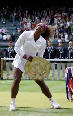 Serena Williams of the United States poses with her trophy after defeating Agnieszka Radwanska of Poland to win the women's final match at the All England Lawn Tennis Championships at Wimbledon, England, Saturday, July 7, 2012. Photo: Kirsty Wigglesworth / AP