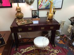 Vintage French mahogany campaign style desk with unexpected, lovely  brass trim on feet and stretcher.  Vintage in Atlanta. Available for sale.