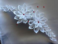 White hair piece features  beautiful handmade satin Kanzashi flowers.