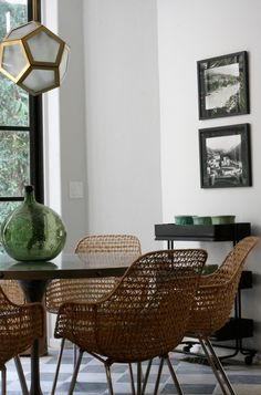 Honeycomb pendant, wicker mid century chairs and a tulip table--image via Garrison Hullinger