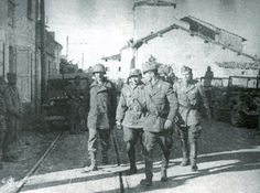 Italian General Mario Carloni and his Chief of Staff capitulating after Brazilian soldiers siege