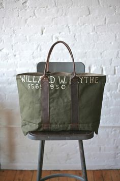 WWII era Canvas Carryall - FORESTBOUND Bag measures approximately 22 in wide, 15 in tall, 4.5 in deep.  Strap drop approximately 8.5 in.  Fully lined with olive colored cotton  Sturdy, worn-in canvas salvaged from a WWII era US military duffel bag 230.00