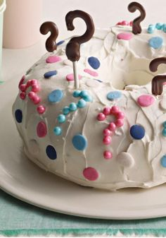 Reveal Cake – He or she? Open to see! This gender reveal cake recipe is perfect for any baby shower.