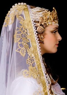 North Moroccan Bride (This is what my cousin Jamila looked like at her wedding. She's the one who's helping coordinate.-L.)