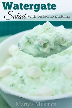 This easy and delicious Watergate Salad made with pistachio pudding, pineapple, whipped topping and marshmallows is a winner for potluck and family dinners.