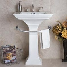The Pedestal Sink Towel Bar is a great solution for small bathrooms.This bathroom towel bar wraps around the base of a pedestal sink to provide a handy spot for guest towels.  $17.99  - mounts to wall