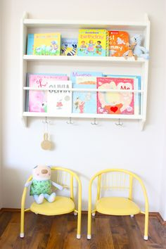 A plate rack hung low enough for little people to reach + a couple of chairs = a handy reading spot