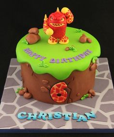 This amazing Skylanders birthday cake features Eruptor and is personalized with the birthday boys name and age. This party page also includes personalized invitations, officially licensed party supplies, favors and more.