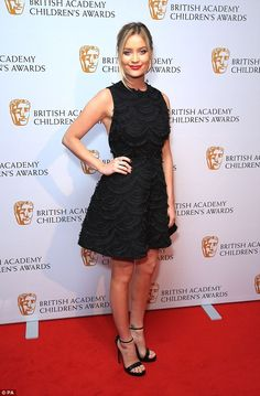 Sizzling stunner: The 31-year-old Irish beauty looked typically sensational in a flirty black skater dress while adding a splash of detail to the ensemble with her bold lip-shaped clutch bag, which coordinated perfectly with her own lipstick