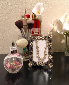 Perfume bottle with swarovski beads in pink.