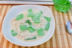 Coconut Pandan Salad is a popular Filipino dessert consisting of pandan flavored gelatin, shredded young coconut, cream and sweetened milk.