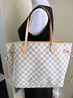"Louis Vuitton ""neverfull Damier"" Mm In Great Condition Shoulder Bag. Get one of the hottest styles of the season! The Louis Vuitton ""neverfull Damier"" Mm In Great Condition Shoulder Bag is a top 10 member favorite on Tradesy. Save on yours before they're sold out!"
