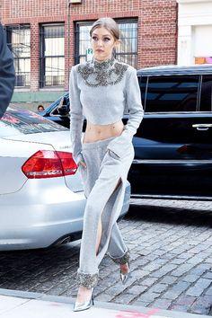 On Gigi Hadid: Sally LaPointe Cropped Top ($2150) and Sweatshirt Slit Pant ($1950); Stella Luna silver pumps.