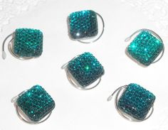 Are your bridesmaids wearing aqua.   These would be the perfect hair accessory.  Dazzle their hair at your wedding. 6 Hair Swirls in Dazzling Bright Teal Squares  by hairswirls1, $11.99
