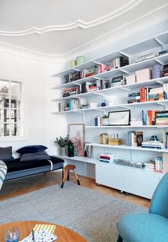 We love how this living room was transformed into a practical and pretty gathering room with a bookcase wall for smart storage.