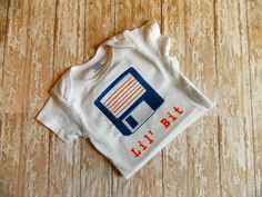 Computer Nerdy Baby Bodysuit. Floppy Disk Lil Bit, IT geek baby gift, funny, old school infant, Baby Genius, Dorky Shower gift, Nerd Swag by SewNerdyGifts on Etsy https://www.etsy.com/listing/228629611/computer-nerdy-baby-bodysuit-floppy-disk