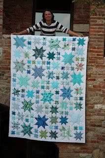 Instructions for this quilt can be found here: http://thoughtandfound.wordpress.com/2011/11/17/oh-my-stars-a-quilt-along/