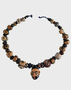 "Phoenician-made necklace with glass eye beads and a central head pendant, recovered from Grave 1 at Tharros, Sardinia.  ca. 600 - 300 BC. | Collection: British Museum, London. | Pg 313 ""The Worldwide History of Beads"" by Lois Sherr Dubin. 2009 edition."
