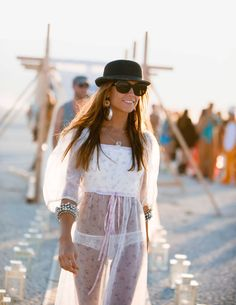 Top of the Morning to Ya! | A masculine bowler hat contrasts with a sheer chiffon dress for the desert | Burning Man 2013 | Photography by Andi Hatch | Town & Country Magazine