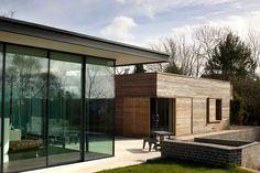Fineline aluminium glazing. Very crisp. Miesian roof detail. & glazing showroom | Door opener Showroom and Doors