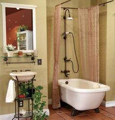 Example of an installed Maverick clawfoot tub with Old World Bronze trim. I love that it still has a stand up shower!