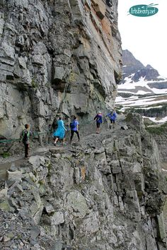 towing the rope line on highline trail glacier national park montana family hiking trip outdoors mountains nature beauty