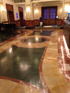 working on the floor of a hotel foyer Hotel Foyer, Sparkling Drinks, Artificial Stone, Kitchen Worktop, Stone Flooring, Restoration, This Is Us, Indoor, Places