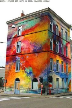 Colorful building street art by Karsten Mouras: I love the gold into orange into red sections...