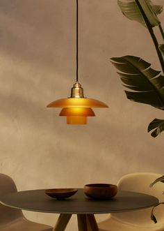 Iconic PH lamp by danish designer Poul Henningsen in a warm gold colour