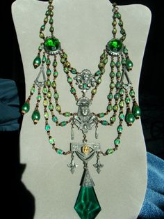 HUGE FESTOON jeweled Uranium green vaseline Czech glass beads ANTIQUE old repousse Statement Egyptian Revival Art Nouveau Steampunk Necklace. $169.99, via Etsy.