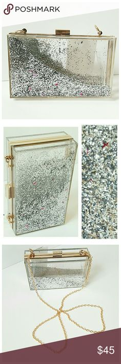 PLF2016 HOST PICK! LUCITE FLOATING GLITTER CLUTCH - NWT  - Skinny dip - LUCITE, Silver and Fuschia glitter,  gold metal finishings -7x4x2.25in - THE clutch for the holiday season!! - Trendy clear lucite, silver glitter and pink stars glitter float around changing the design with movement!  Detachable  gold link strap ASOS Bags Clutches & Wristlets