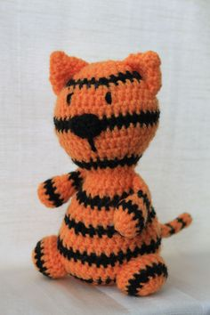 Timothy the tiger. Amigurumi plush animal. The animal is approximately 20 cm tall.