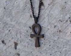 Check out our ankh charm selection for the very best in unique or custom, handmade pieces from our charms shops. Ankh Necklace, Matte Black, 18k Gold, Jewerly, Charmed, Unisex, Unique Jewelry, Chain, Pendant