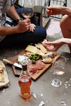Salumi, cheese and wine on the balcony
