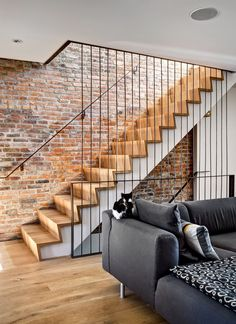 The stairs were made of old-growth white oak by Steve McKinney, of Historic Flooring in Tennessee, to match the floor boards, which he also supplied. To make the stairs, Mr. McKinney laminated random-width boards into a single 12-foot piece, which he then sliced into steps and risers so that the grain would align all the way up. Mr. Krone finished the steel guard rail and banister himself.