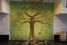 This client of ours in Aylesbury, Buckinghamshire, wanted a splashback with lots of personal touches. Their pet dog was always chasing crows, so they wanted that represented on the glass. We often make lots of personal touches to our tree of life designs, but that doesn't mean you can't get one without anything special on there. The tree of life design is beautiful enough to brighten up a room on its own, and they're still especially effective as centrepieces.