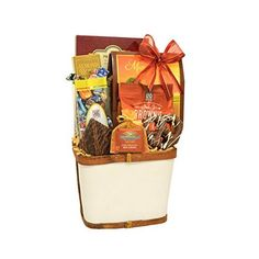 This natural wooden gift basket with cane accents features a gourmet selection of treats. Basket includes: Gourmet Almond Pecan Popcorn, Chocolate Salted Caramel Cookies, Chocolate