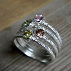 4 birthstones for each family member, 1 ring.
