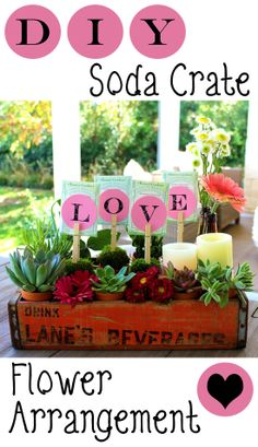 DIY flower arrangement in an old soda crate. How adorable!