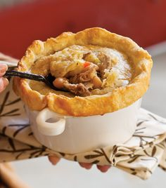 Roasted Pork and White Bean Pot Pies : Crust: Crust 2(11-ounce) packages piecrust mix, such as Betty Crocker 2⁄3cup cold water 1⁄4cup plain yellow cornmeal 2large egg yolks, lightly beaten 1teaspoon kosher salt, divided