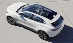 The Lincoln MKC concept uses a panoramic glass roof.  I wonder how they're dealing with heat in parked cars.